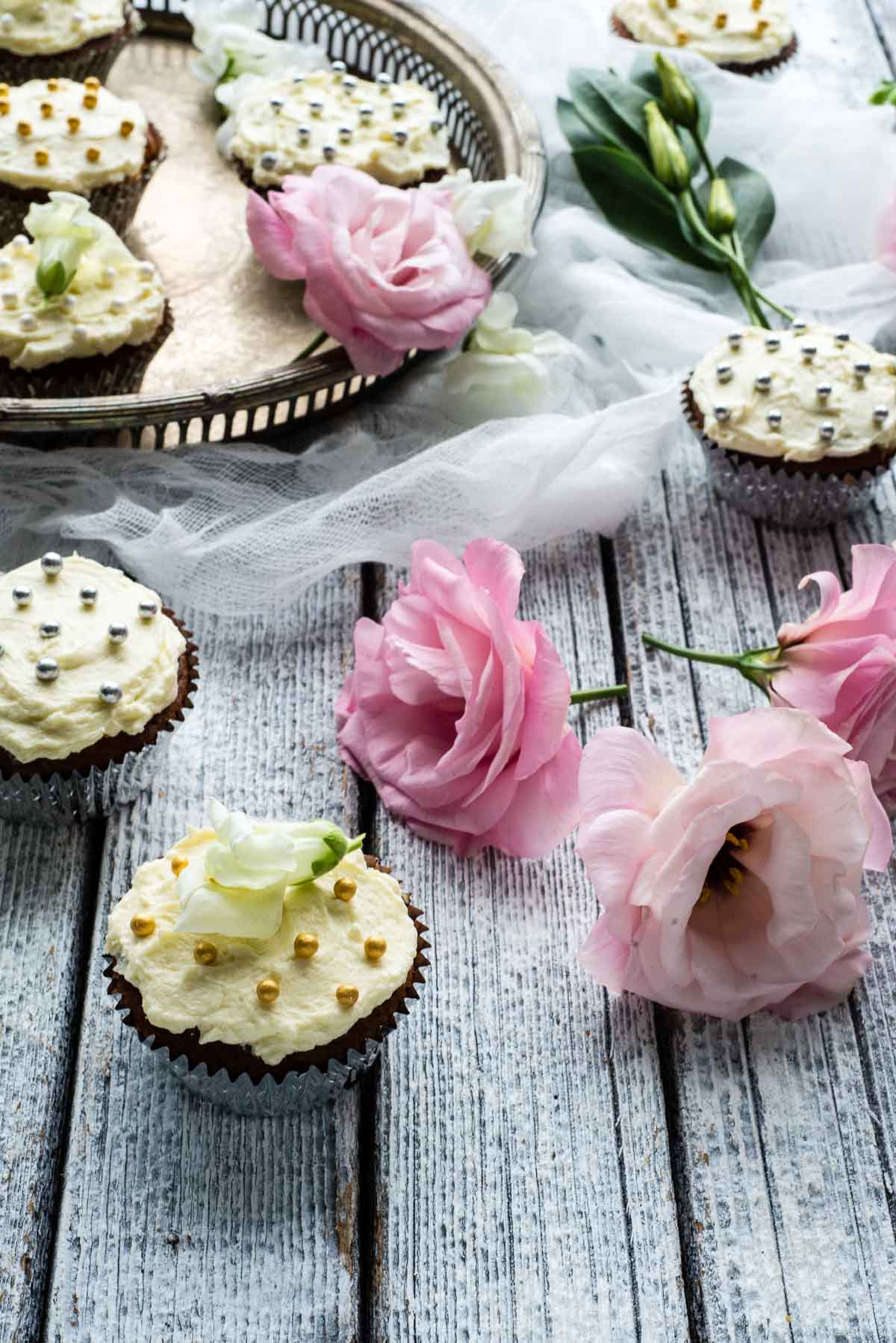 pretty white cupcakes and flowers