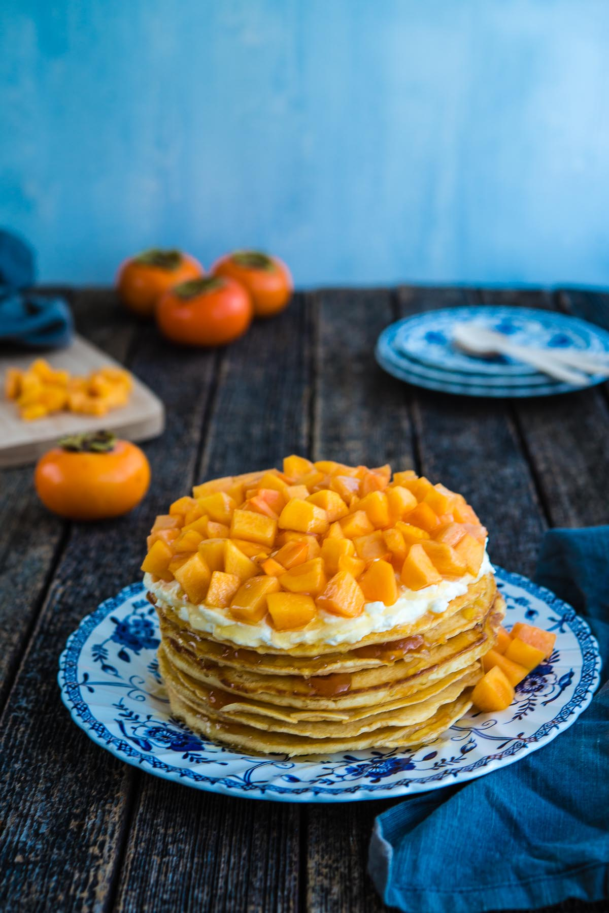 stacked pancake cake with persimmons