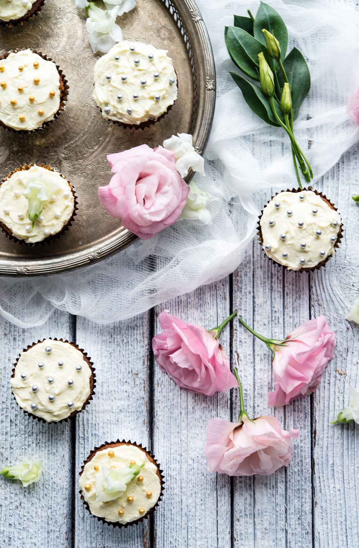 white chocolate cupcakes and flowers